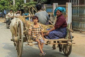 Burmese people traveling by cart