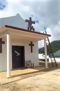 A United Wa State Army (UWSA) militant toppling a cross on a church building. - Photo: Facebook via Morning Star News