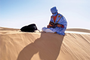 Man reading in the desert - The Voice of the Martyrs U.S. - www.icommittopray.com