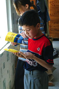 Children in Tajikistan read Gospel books.